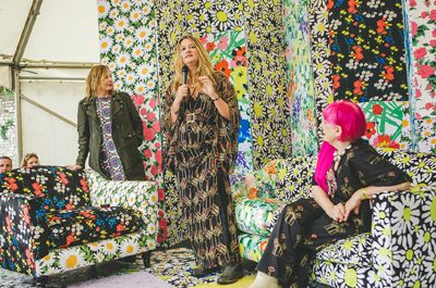 Fashion royalty interviewed on Epson-decorated festival stage